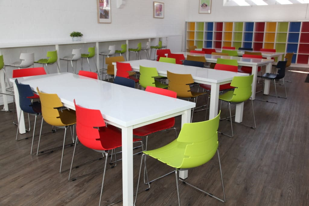 Colourful tables and chairs in a classroom