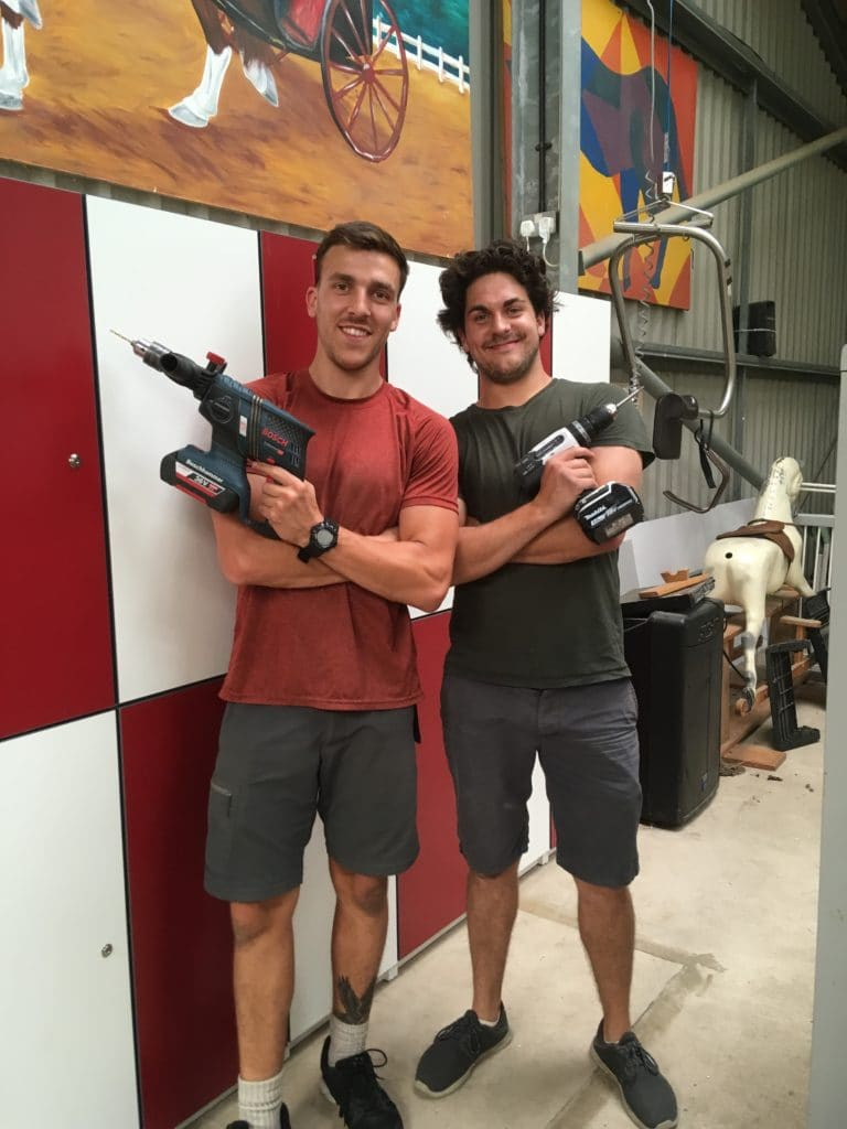 Two men with power tools