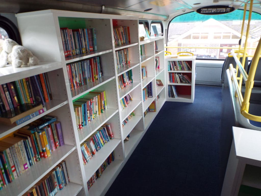 Kings Hawford celebrate opening of double decker bus library