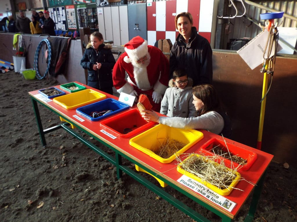 Adults and children using the sensory table